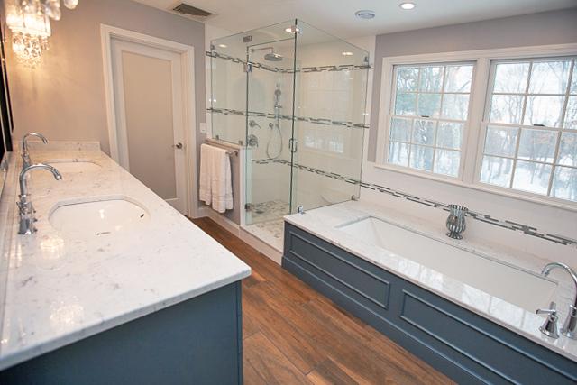 Bathroom design with tub by window