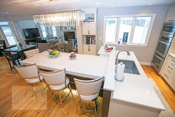 Kitchen design with chandelier over island