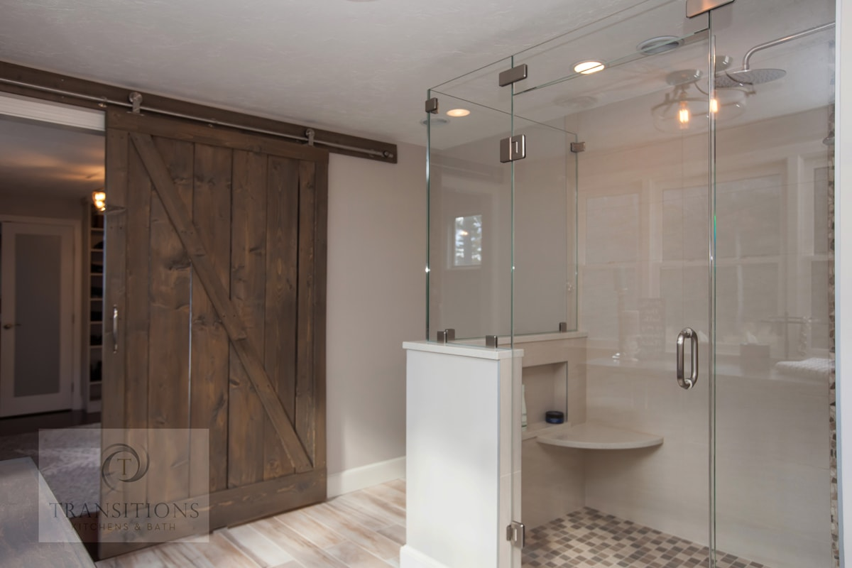 Contemporary bathroom design with sliding barn door