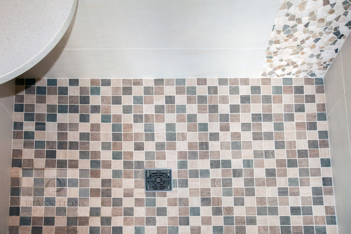 Bathroom design with mosaic tile floor