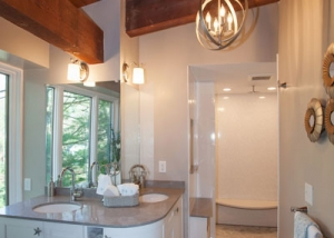 Contemporary bathroom design with rustic barn beams