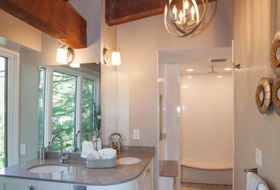 Contemporary bathroom design with rustic barn beams