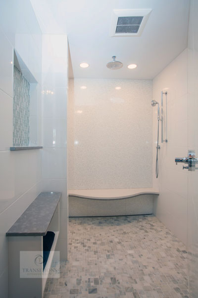 Large shower with rainfall and handheld showerheads