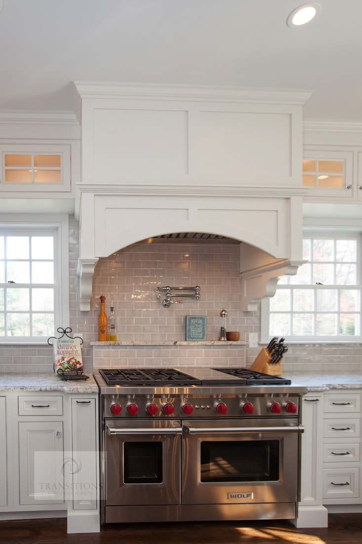 kitchen design with narrow pull out storage next to oven