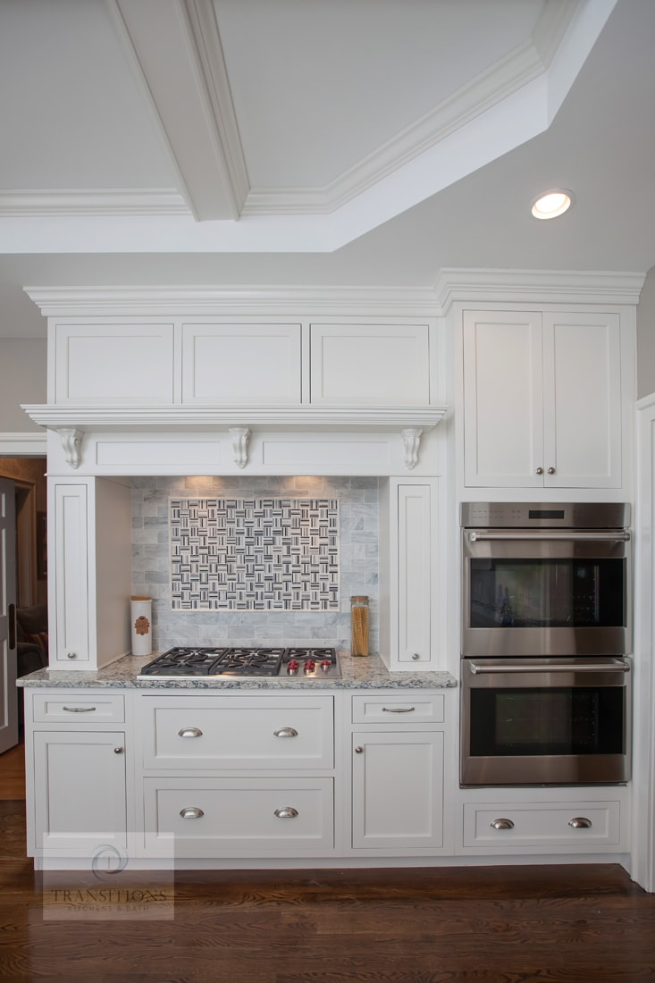 White kitchen design with backsplash tile feature