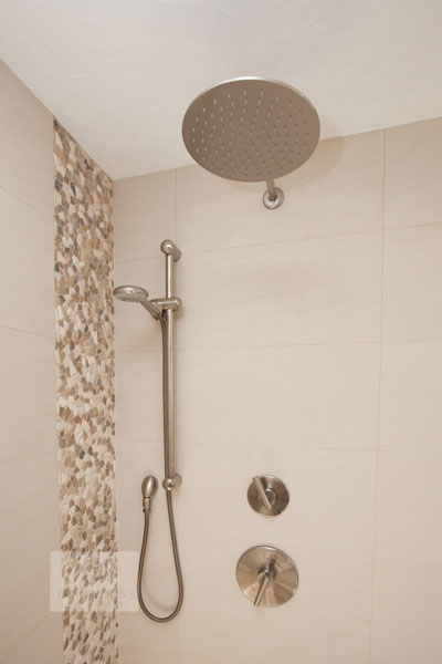 Shower design with multiple showerheads