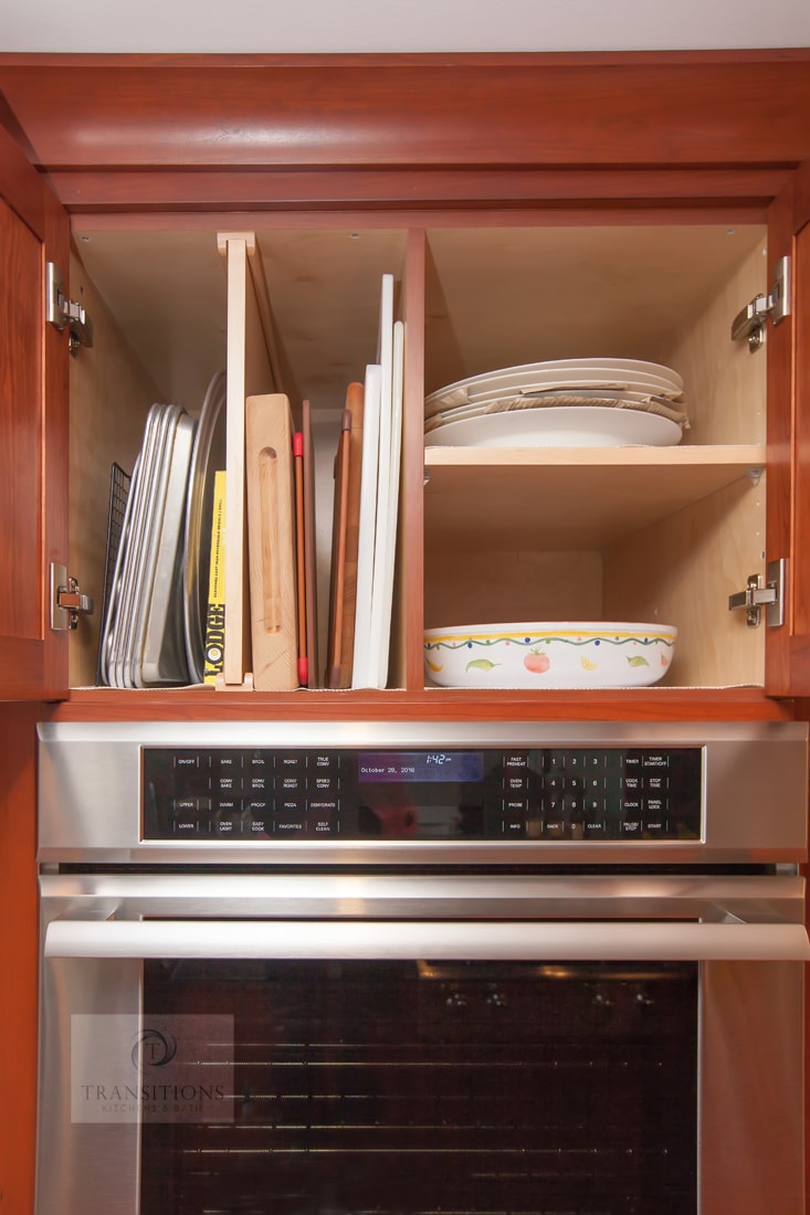 kitchen design with vertical tray storage