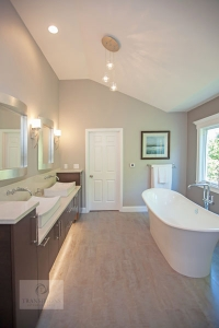 Bath design with two sinks and freestanding tub