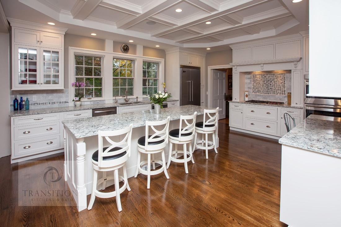White kitchen design with island