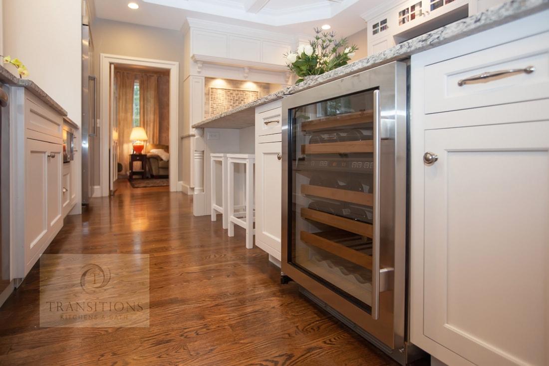 White kitchen design with undercounter wine regrigerator