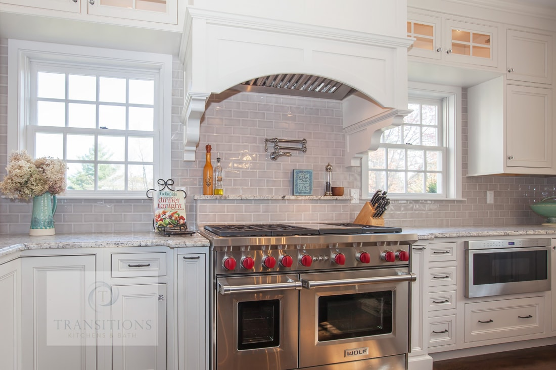Traditional kitchen design with wood mantel hood