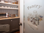 Traditional kitchen design with walk in pantry and custom door