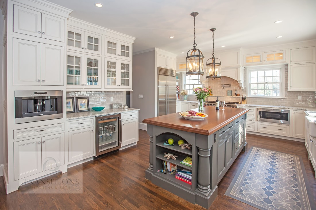 Traditional kitchen design with gray island