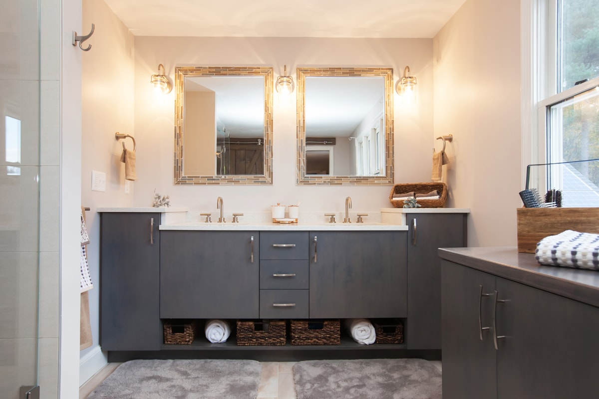 Bathroom design with two vanity cabinets.