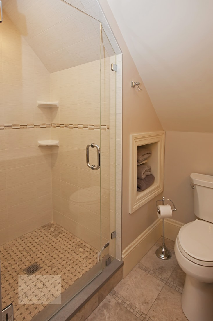 Bath design with large shower with corner shelves