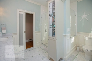 Bath design with glass shower enclosure