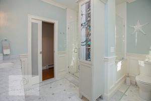Bath design with glass shower enclosure