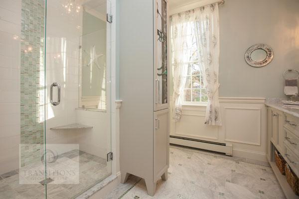 Bath design with corner shower shelf