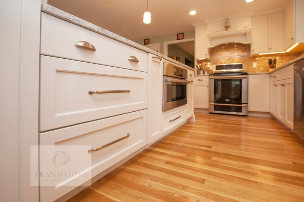 White Kitchen Design With Wood Floors