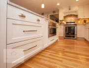 white kitchen design with wood flooring