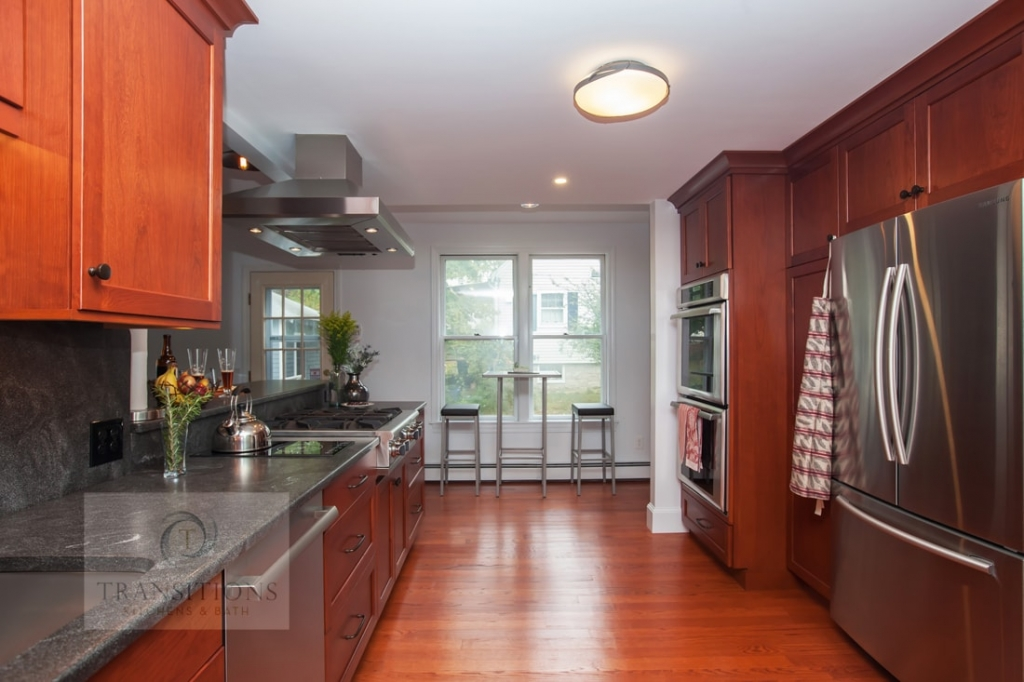 Kitchen design with warm wood floors