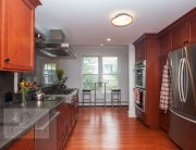Kitchen design with warm wood floors