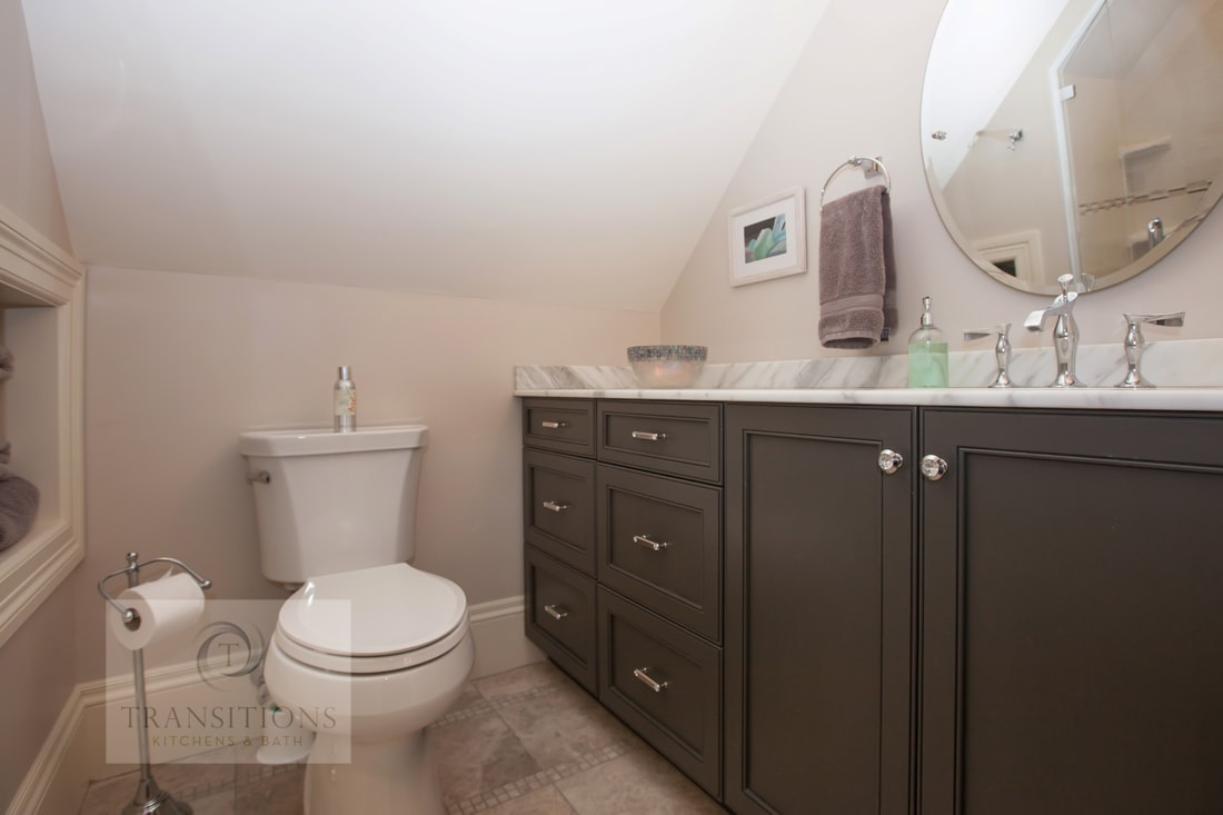 bathroom design with dark wood vanity cabinet