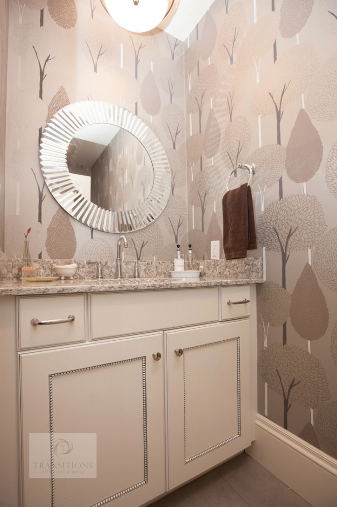 Powder room design with patterned wallpaper