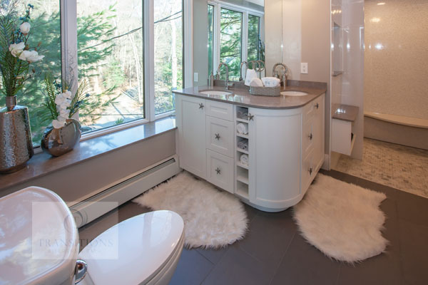 bath design with rounded vanity cabinet
