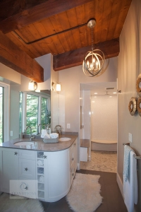 Bath design with large open shower and curved vanity