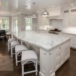 White kitchen design with large island