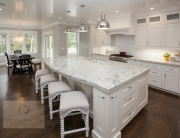 White kitchen design with large island