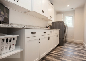laundry room design with white cabinets