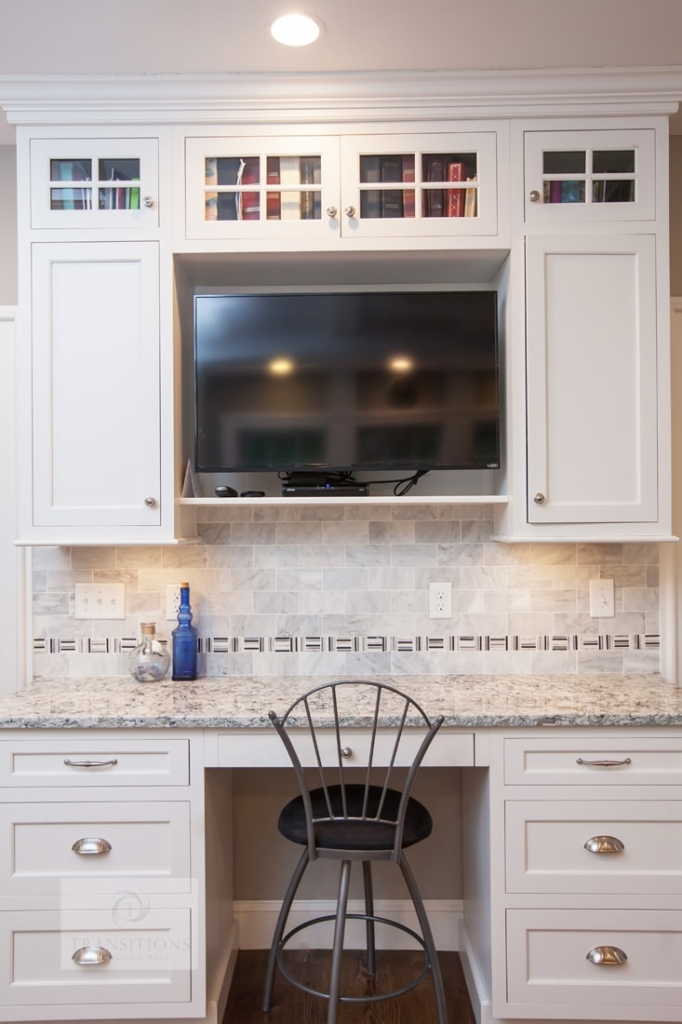 white kitchen design with built in television