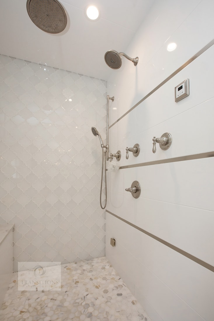 large shower with multiple showerheads
