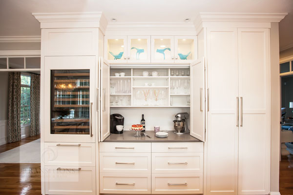 White kitchen design with glass front cabinets