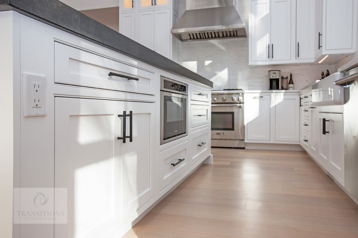 white kitchen design with hardwood floor