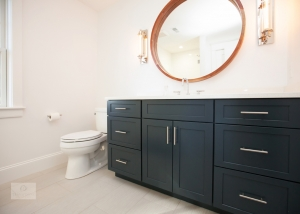 bath design with blue vanity