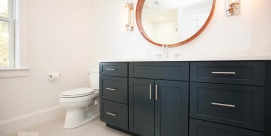 bath design with blue vanity