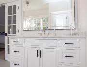 Bath design with white vanity cabinet
