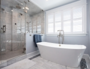 bath design with steam shower and freestanding tub