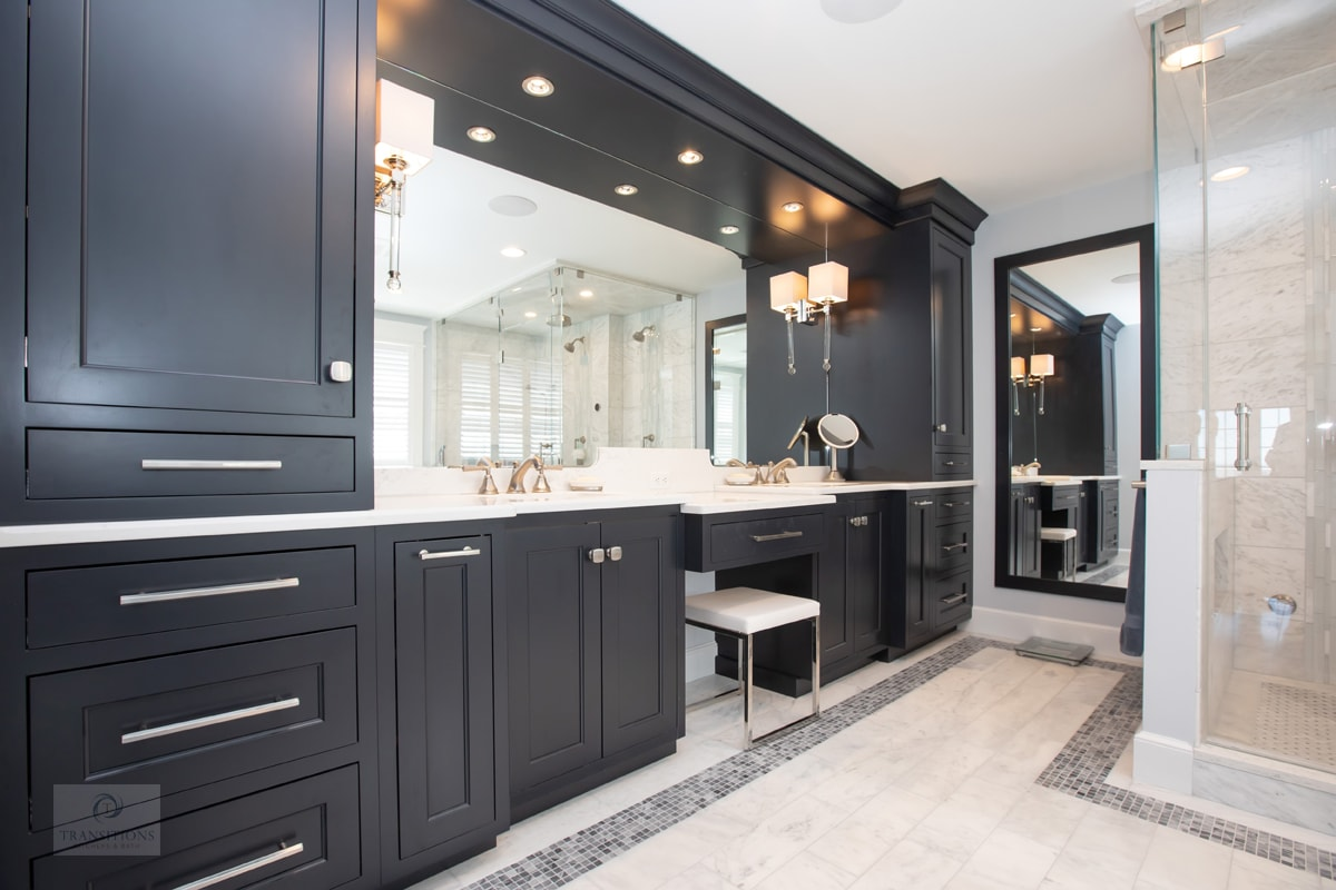 bathroom design with dark vanity