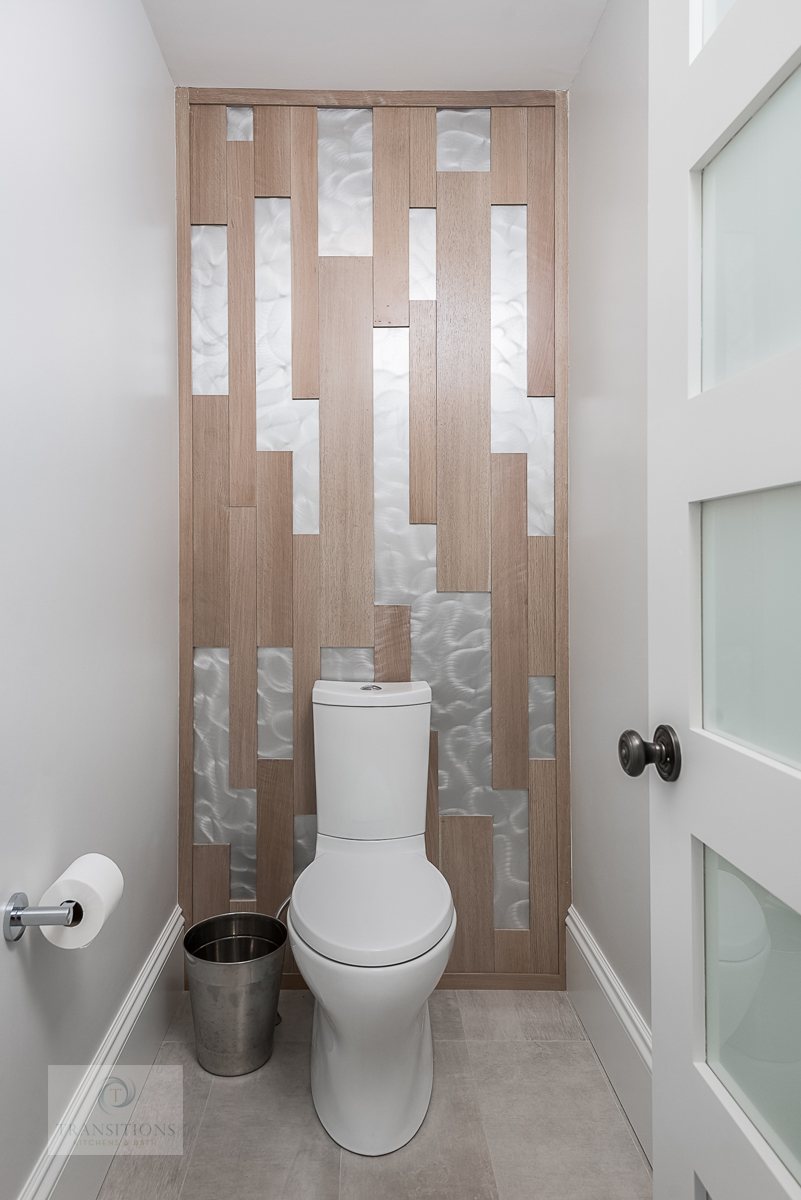 bathroom with aluminum and wood wall