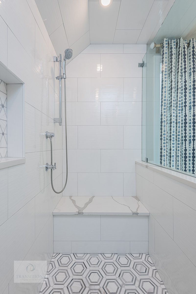 large shower with built in bench