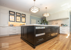 large kitchen island and glass front cabinets