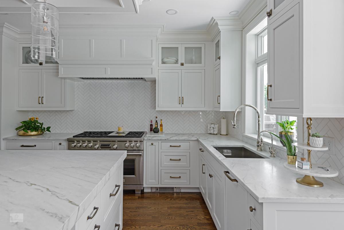 white kitchen design with custom hood