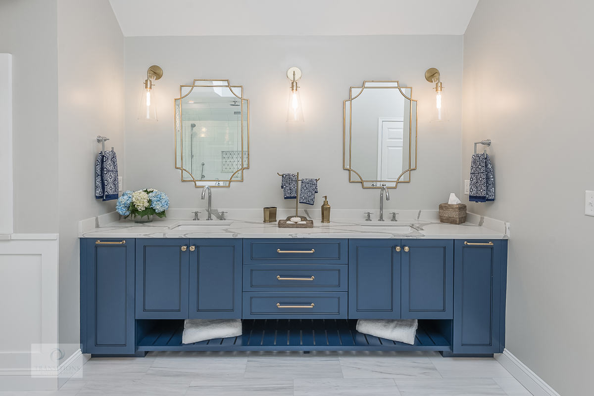 master bath with blue vanity