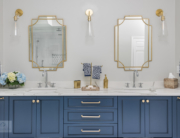 master bath with blue vanity cabinet