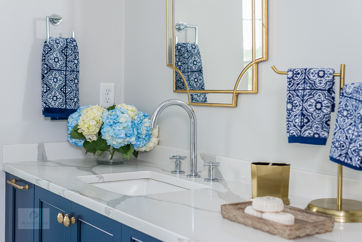master bath with gold and blue accents