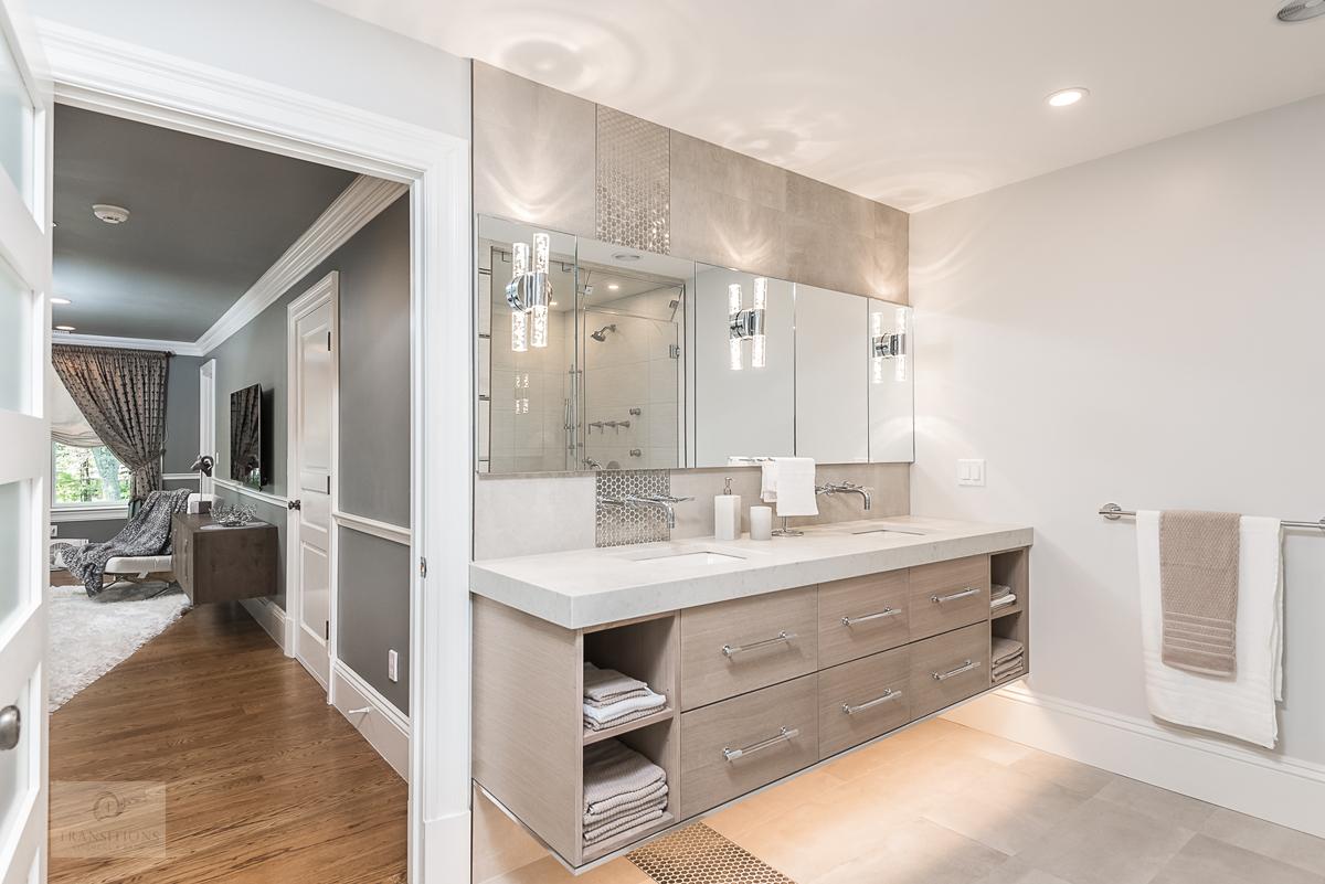 bathroom with wall mount vanity